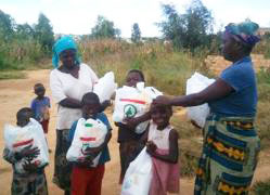 Distributing meal supplements in Lusaka, Zambia