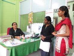 Field staff (Shilpa and Priya) visiting with Sane Guruji Primary School principal Mangalu Kamle