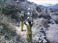 Walking through mountainous  trails to fetch water