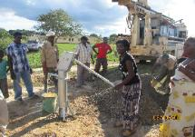 Water committee member trying out the new hand pump