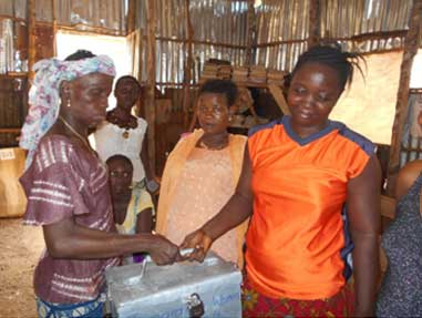 Tamemsu Women's Savings and Loan Assoc. collecting their shares in the lock box